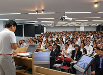 "All Rakuten employees gather at morning information sharing meeting ""Asakai"" once a week."